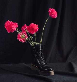 Pink flowers in dark boot