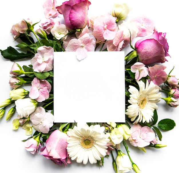 Pink flowers in frame with white square for text