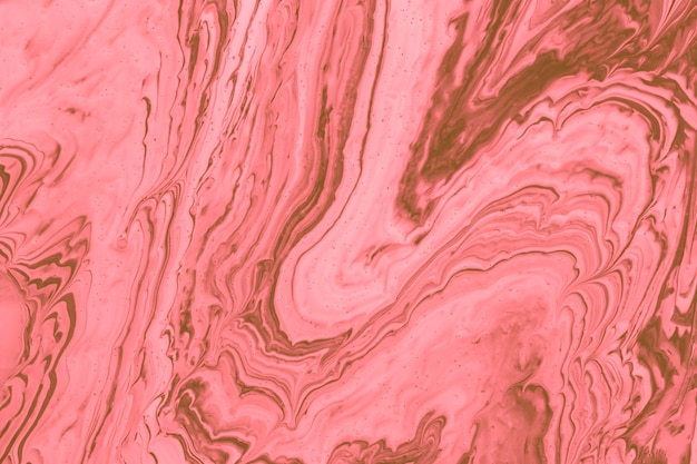Pink fluid acrylic pour painting