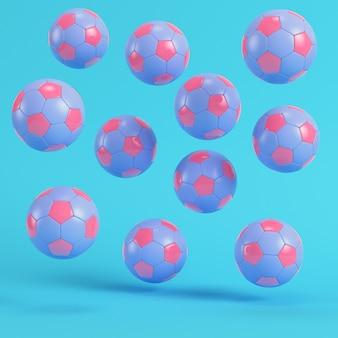 Pink flying soccer balls on bright blue background