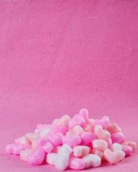 Pink foam hearts pink paper background