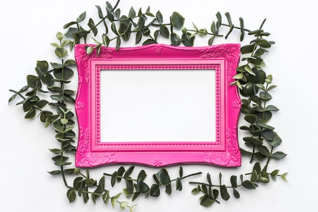 Pink frame green leaves vintage background