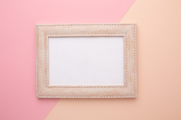 Pink frame on a pink background with a place for an inscription. high quality photo