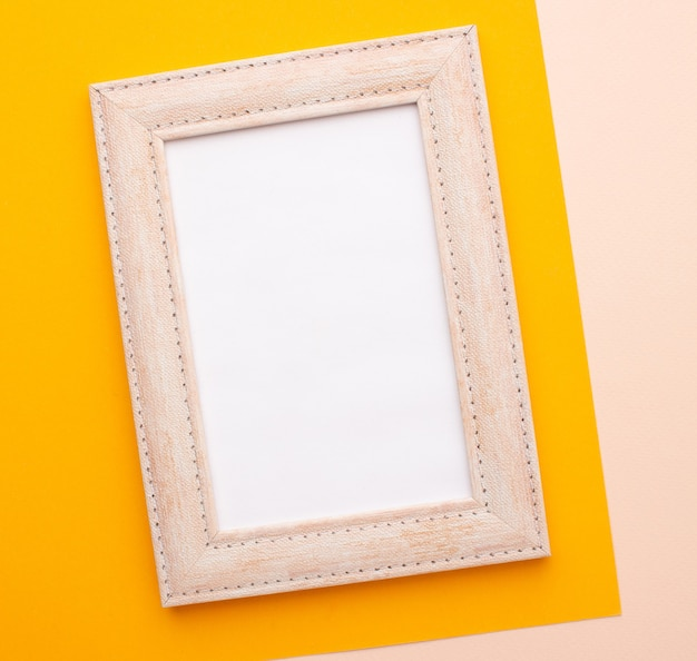 Pink frame on a pink and orange background with a place for an inscription. high quality photo