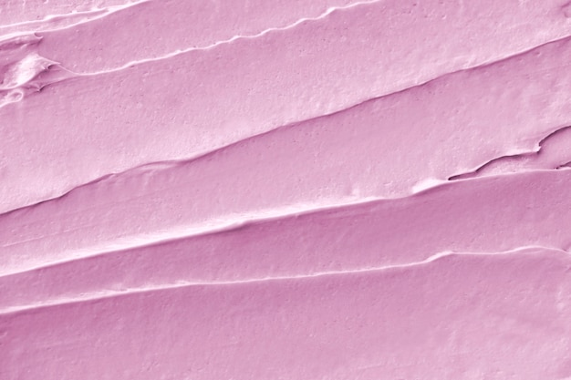 Pink frosting texture background close-up