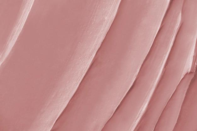 ピンクのフロスティングテクスチャ背景のクローズアップ
