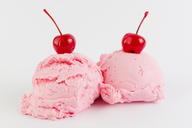 Pink gelato melting balls with cherry above