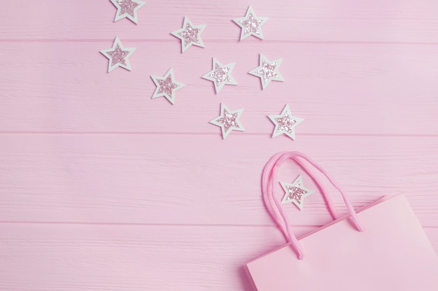Pink gift bag and glitter confetti