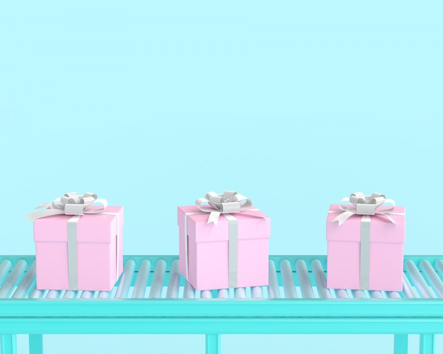 Pink gift box on conveyor roller and blue pastel color background.