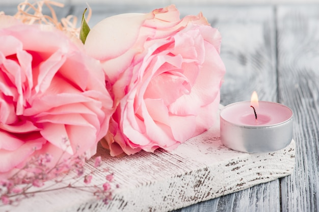 Pink gift box, roses, lit candle