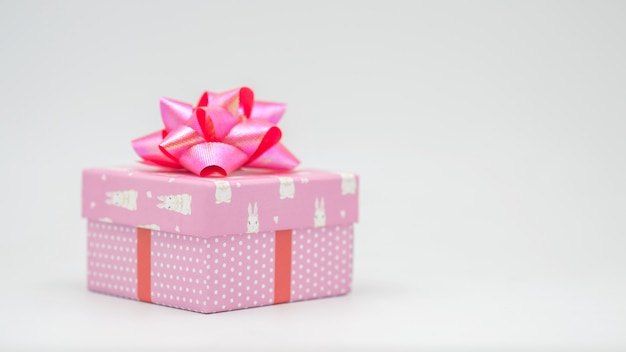 Pink gift box with pink ribbon on a white background congratulations on various occasions - pictures