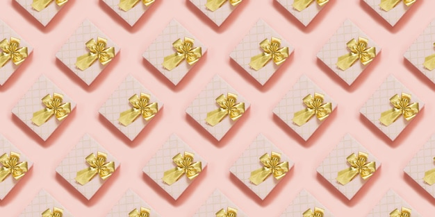 Pink gift boxes with golden ribbon on pastel pink surface. top view. seamless pattern.