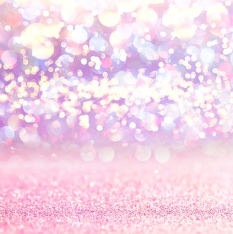 Pink glitter lights bokeh background. defocused