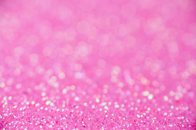 Pink glitter texture. new year or christmas background for greeting card. valentines day celebration. shiny sparkle design for festive decoration: wedding, holiday or anniversary party.