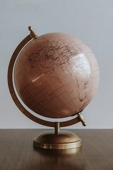 Pink globe sphere in a room