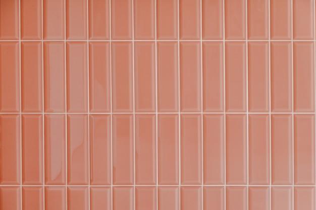 Pink glossy upright rectangular ceramic tile, background, texture.