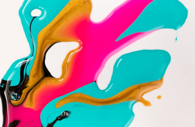 Pink, gold and blue mixed inks on white paper background.