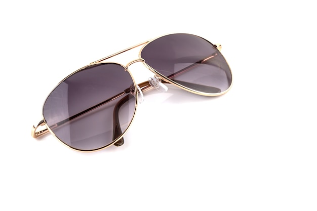 Pink gold elegant sunglasses isolated on  white background