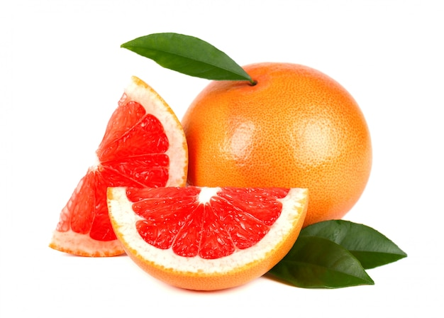 Pink grapefruit and slices isolated on white space with clipping path. isolated grapefruits. fresh grapefruit with green leaves isolated.