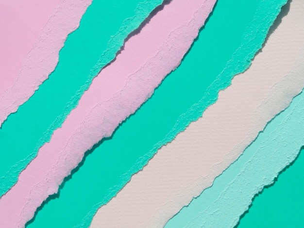 Pink and green oblique ripped abstract paper lines