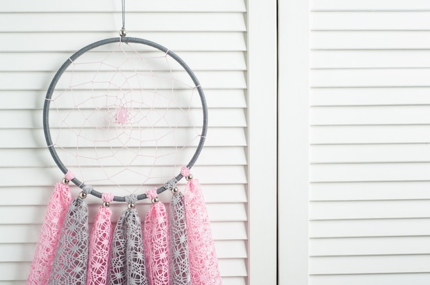 Pink grey dream catcher with crocheted doilies