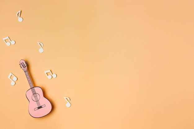 Pink guitar with white musical notes