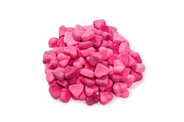 Розовые мармеладные конфеты. вид сверху. желейные конфеты. отдельный на белом фоне.