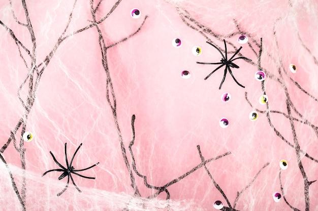 거미줄, 거미와 괴물 눈 핑크 할로윈 배경.