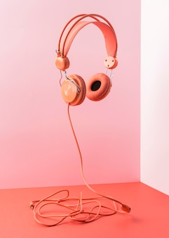 Pink headphones with cable flying