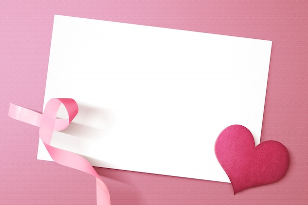 Pink heart and awareness ribbon with empty white paper