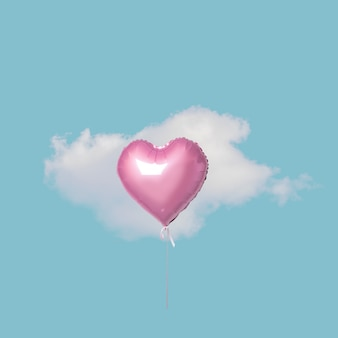 Pink heart balloon with white cloud on blue sky