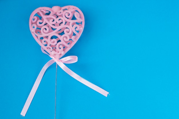 Pink heart on blue background
