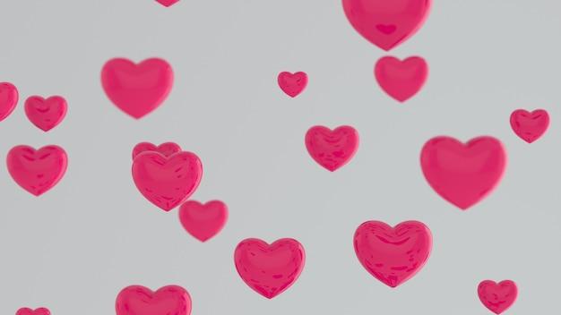 白い壁に飛んでいるピンクのハート