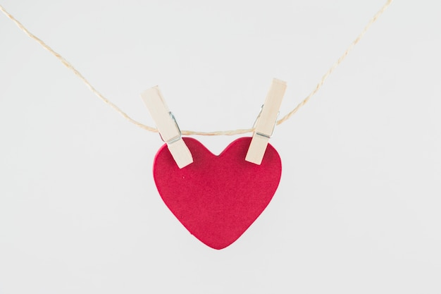 Pink heart hanging on rope