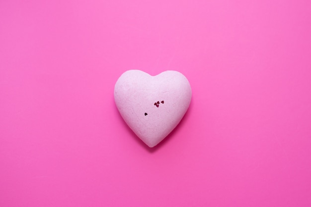 Pink heart on pink background.