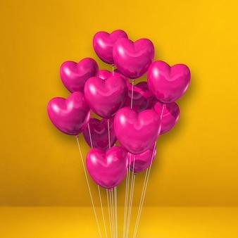노란색 벽 바탕에 핑크 하트 모양 풍선 무리. 3d 그림 렌더링