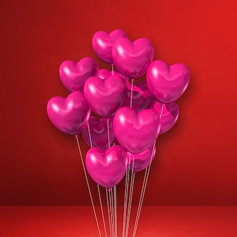 Pink heart shape balloons bunch on a red wall background. 3d illustration render