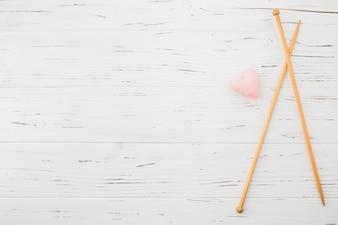 Pink heart shape cushion and crochet plank