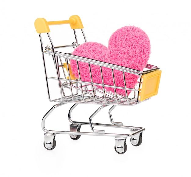 Pink heart on trolley supermarket isolated on white background