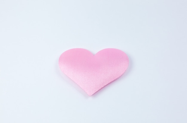 Pink heart on white background. saint valentine's day concept. love and romantic photo. postcard for holiday. beautiful warm wallpaper with love. soft focus. copy space.