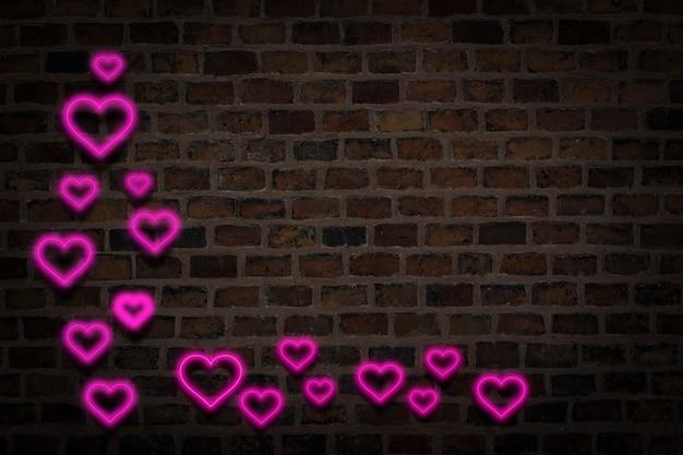 ピンクの心、火の壁の背景にネオンサイン。バレンタインデーのコンセプト、愛。