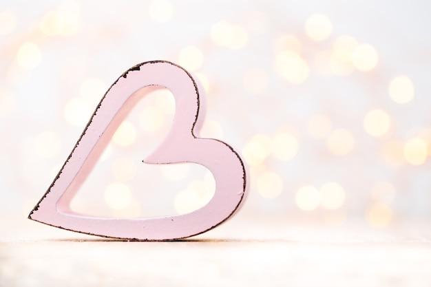 Розовые сердечки на фоне боке. валентина день фон.