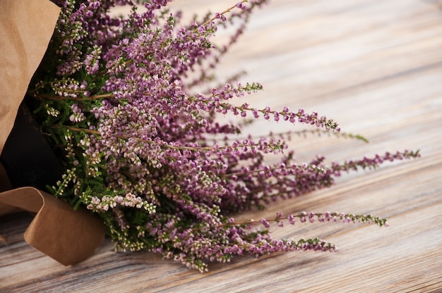 Pink heather on wooden table