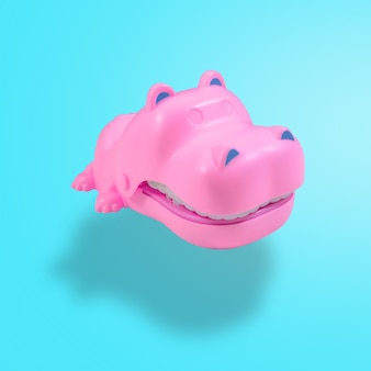 파스텔 블루 배경에 떠 있는 핑크 하마