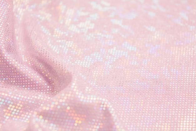 ピンクの休日光沢のある繊維素材背景波とコピースペース