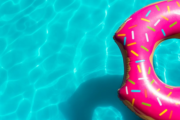Pink inflatable pool toy in swimming pool