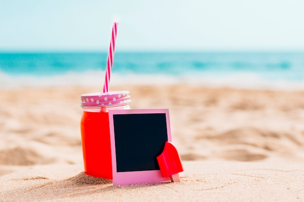 Pink instant photo with smoothie at the beach