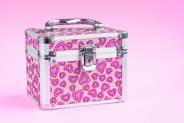 Pink jewelry box isolated on pink background.