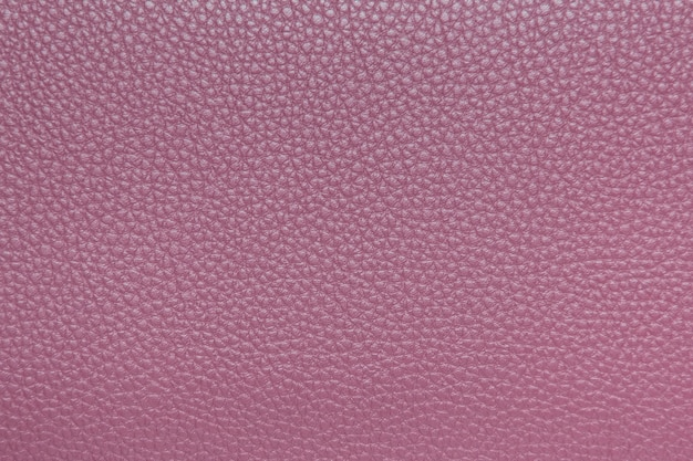 Pink leather texture closeup for background