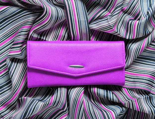 Pink leather wallet on fabric
